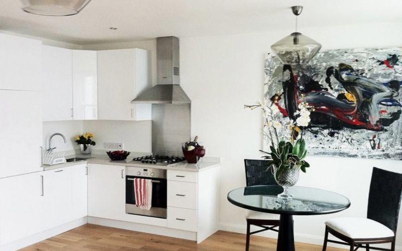 Современные минималистичные угловые кухни